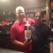Steve with the owner and a big bottle
