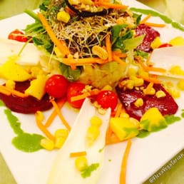 Potato Salad w/ greens, surrounded by beets, mangoes, corn & dressed w/ dried fruits vinaigrette.  Very tasty!