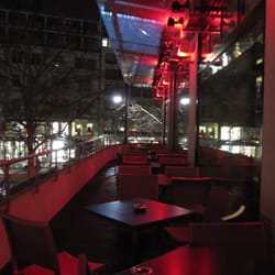 tables on the terrace bathing in red light