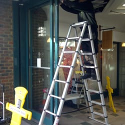 Automatic door engineer carrying out service