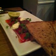 Beetroot cured salmon with furakaki, horseradish creme fraiche, coriander & granary toast
