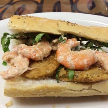 ... , LA, United States. Fried green tomato and shrimp remoulade po-boy
