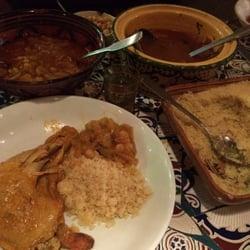 Au P'tit Cahoua - Paris, France. Fassi au poulet on the left and 7 Légumes on the right, huge portions!