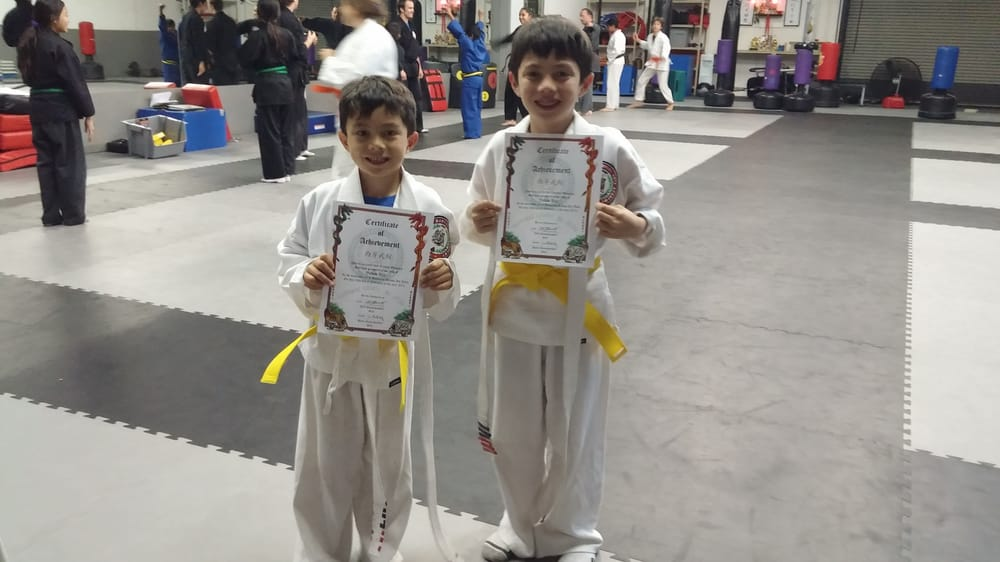 West Coast Martial Arts Academy - San Diego, CA, United States. Nathan and Zachary are all smiles after completing their testing and moving up to yellow belt!!!