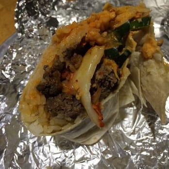 Bulgogi burrito with white rice, kimchee, spicy cucumbers, and cheese ...