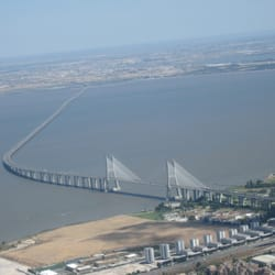 An aerial view of the Vasco da Gama Bridge after takeoff from Lisbon en route to Funchal, Madeira, Portugal.