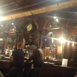 Stag's head behind the bar