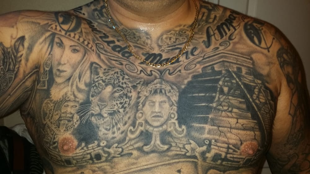 Full chest plate done by jeremy yelp for Chest plate tattoos