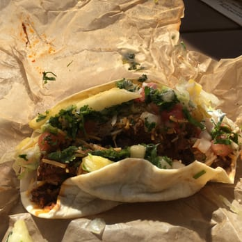 States. Al Pastor taco with fresh pineapple chunks and guajillo salsa ...