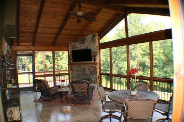 Cedar screened porch with tile floor corner fireplace for Screened in porch fireplace ideas