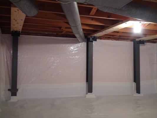 the basement doctor crawl space repaired with whitecap vapor barrier