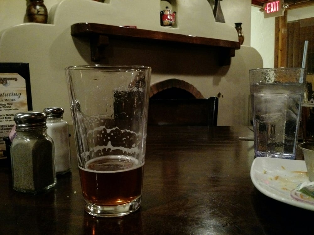 Alien Amber Ale with a great fireplace in the background
