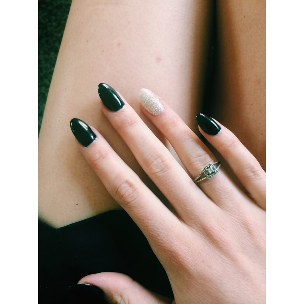 Black stiletto/almond shaped nails with glitter ring ...