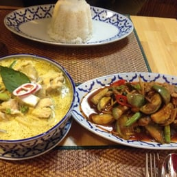 "Left: ""green"" curry (but it tasted and looked more like yellow) and beef w basil leaves"