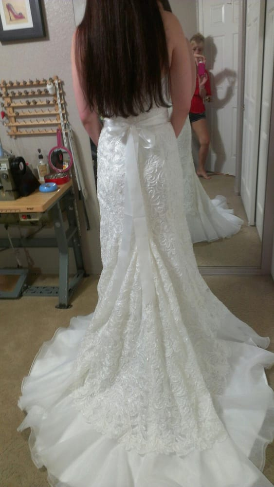 The style of the wedding dress finished before a bustle is for Wedding dress tailor near me