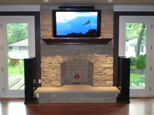Deluxe Home Theater Installation With Def Tech Speakers Denon Reciever And Tv Over Fireplace