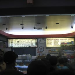 Waiting in line, staring at the menu board..