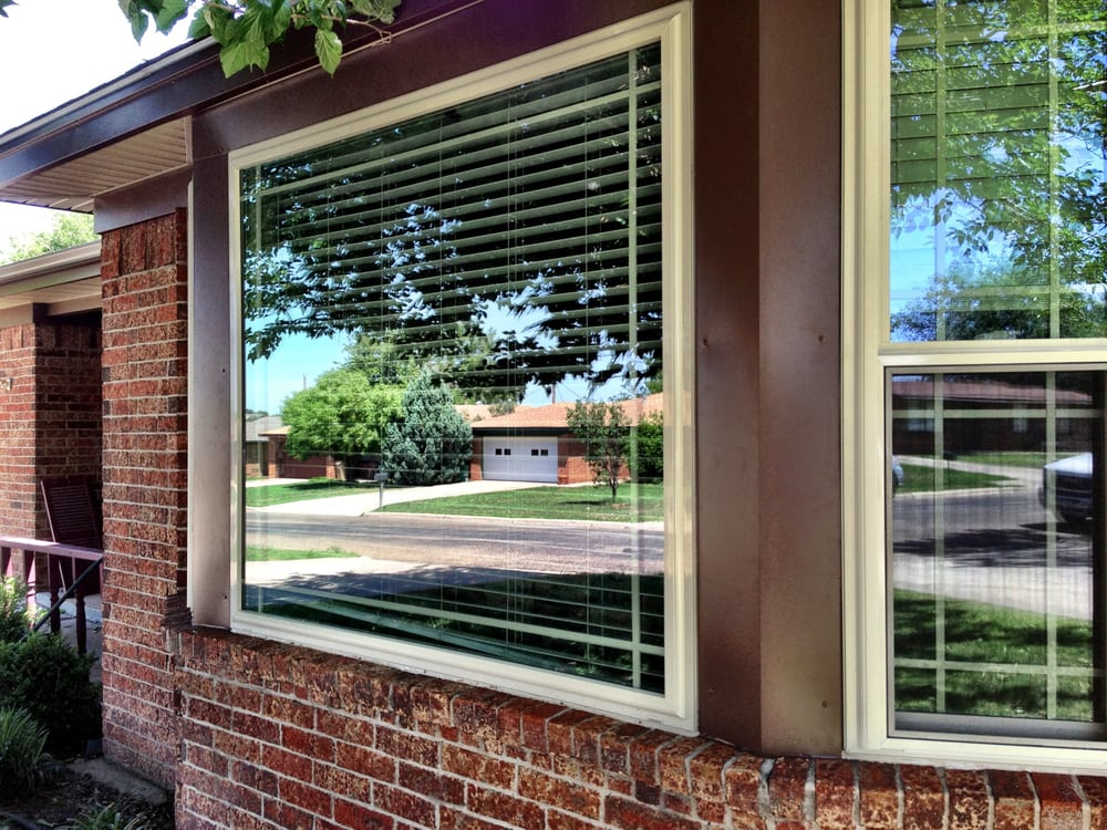 Tan picture window with perimeter grids and brown steel for 5 star windows