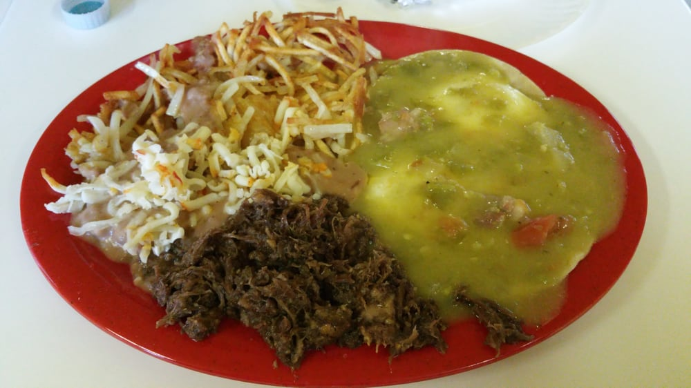 ... Albuquerque, NM, United States. Eggs and green chili with Barbacoa
