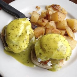... , OR, United States. Risotto cake Benedict with pesto hollandaise