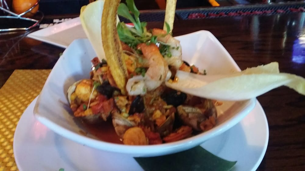 Paella with shrimp, scallops, clams, mussels, fish of the day, chorizo ...