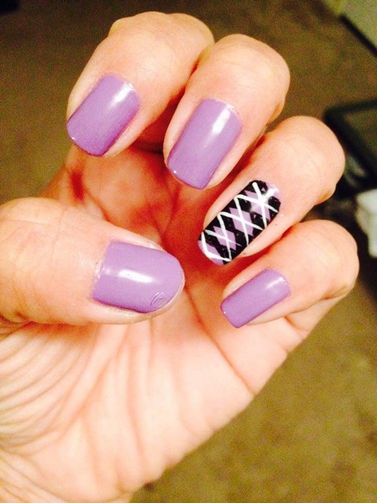 Regular lavender nail polish color. design on the ring finger using