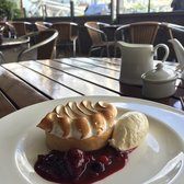Lemon meringue tart w/ french vanilla ice cream and berries sauce
