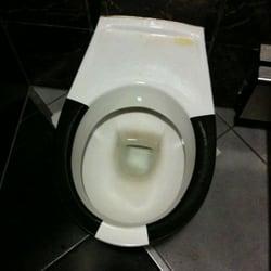 Toilette mit aufgemalter Sitzbrille -…