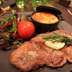 Steak with salad and au gratin potatoes