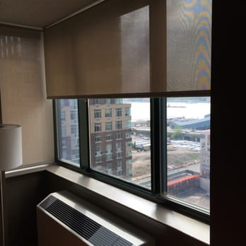 New york window fashion 53 photos 25 reviews shades for Motorized solar shades reviews