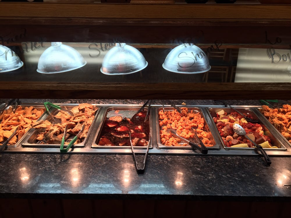 More seafood low country boil fried shrimp steaks more for Fish buffet near me