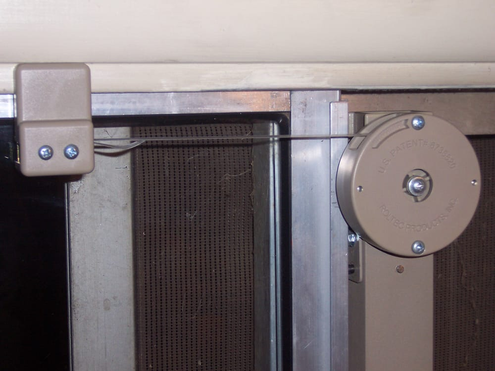 Close Up Of Strap Actuated Door Closer Mounted To Left Handed