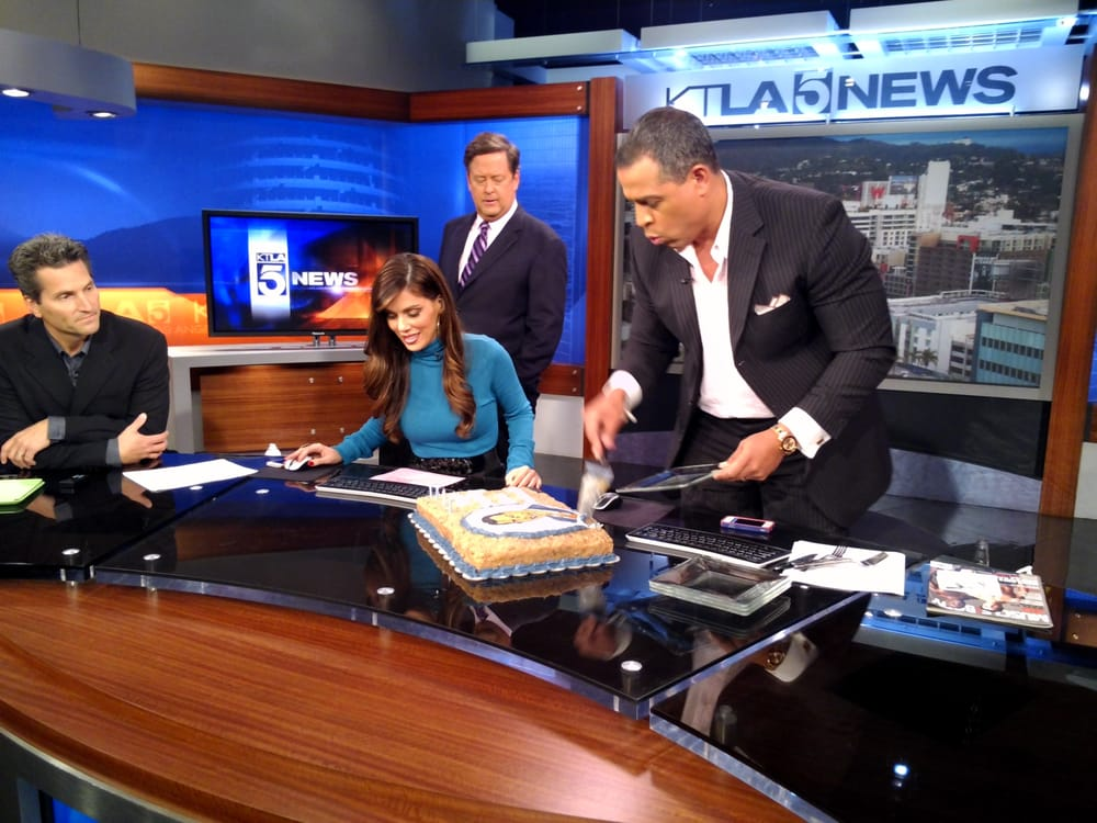 News Anchor Chris Schauble cutting his birthday cake - Yelp