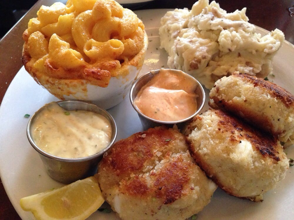Crab cake dinner with sides of garlic mashed potatoes and for What sides go with fish