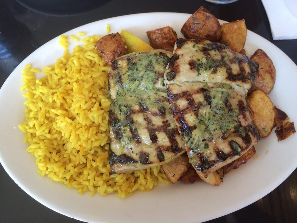 Garlic and herbs yellowtail with yellow rice and rosemary for Bluesalt fish grill