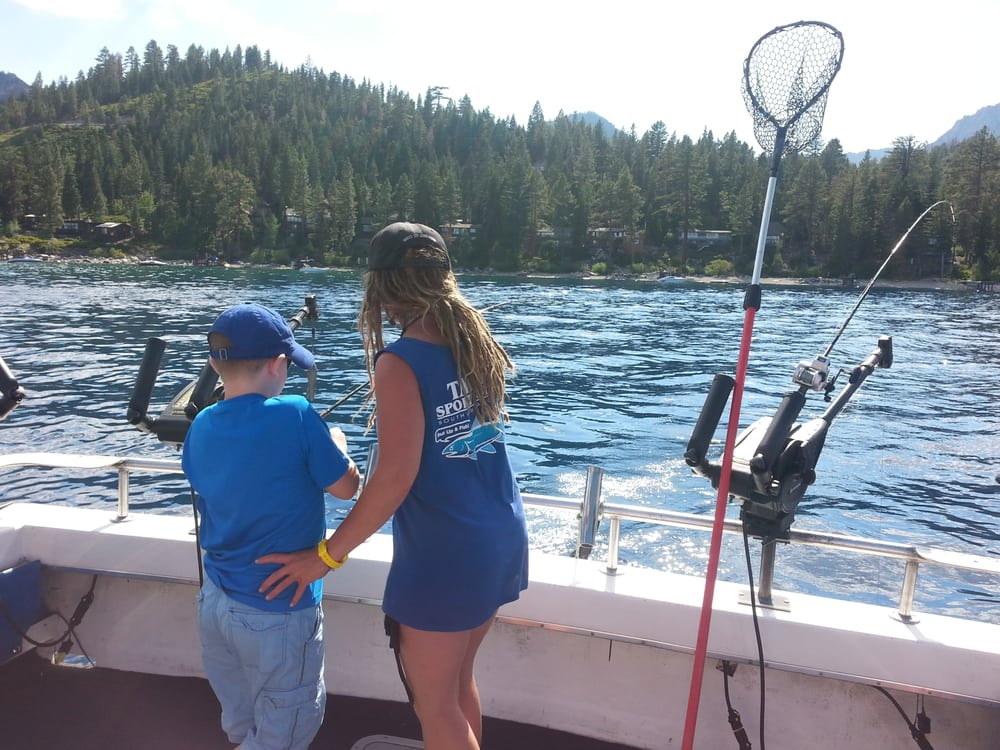First mate jamie helping my 9 year old son luke yelp for Tahoe sport fishing