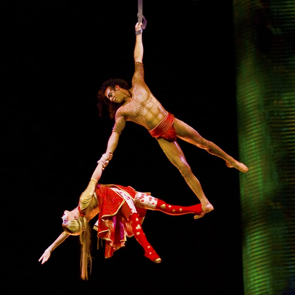 "About O by Cirque du Soleil: ""O"" by Cirque du Soleil is a whimsical and visually stunning show that transports audiences into a fantastical world of wonderment and awe with the use stunning acrobatics surrounded by air, fire and, most prominently, water. Click Here to purchase tickets from $ with Best Price Guarantee!"
