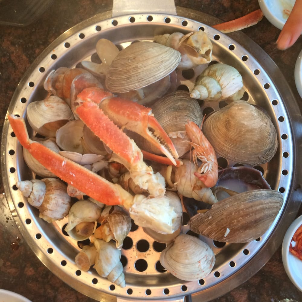 4th tier: various sized clams and sea snails - Yelp