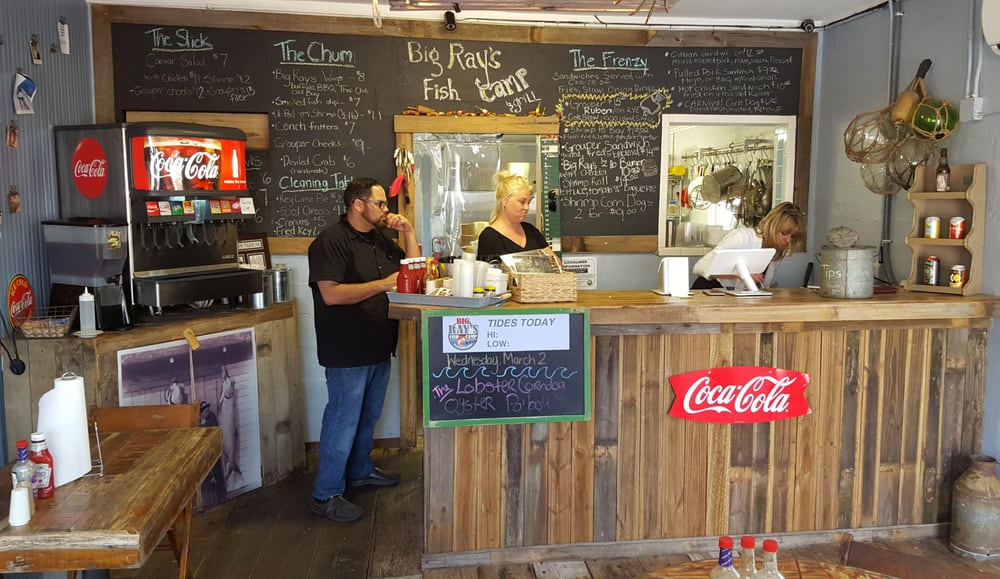 owner nick cruz and lindsey standing behind the counter