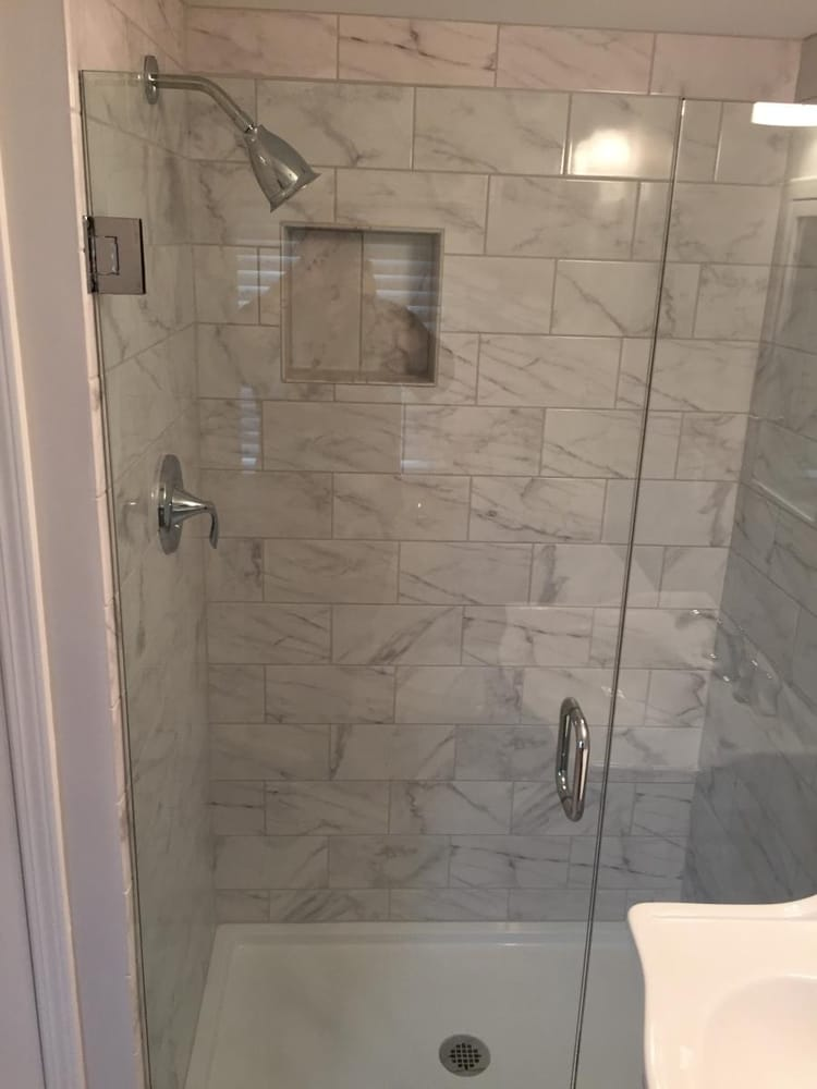 Tile shower remodel in Rocky River, OH features recessed niche ...