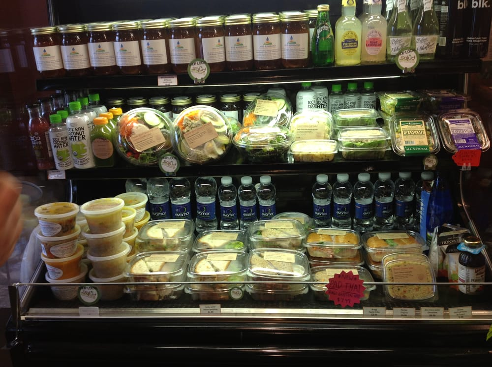 Grab 39 n 39 go food display featuring sandwiches and salads for Cuisine to go
