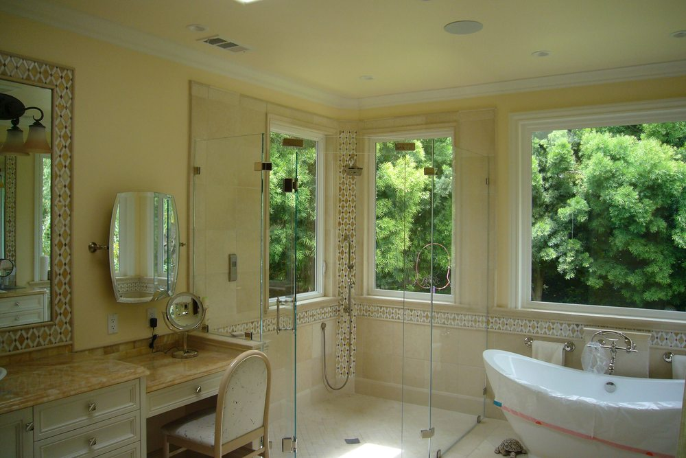 master bathroom with sunken shower, no curb, custom glass and onyx ...