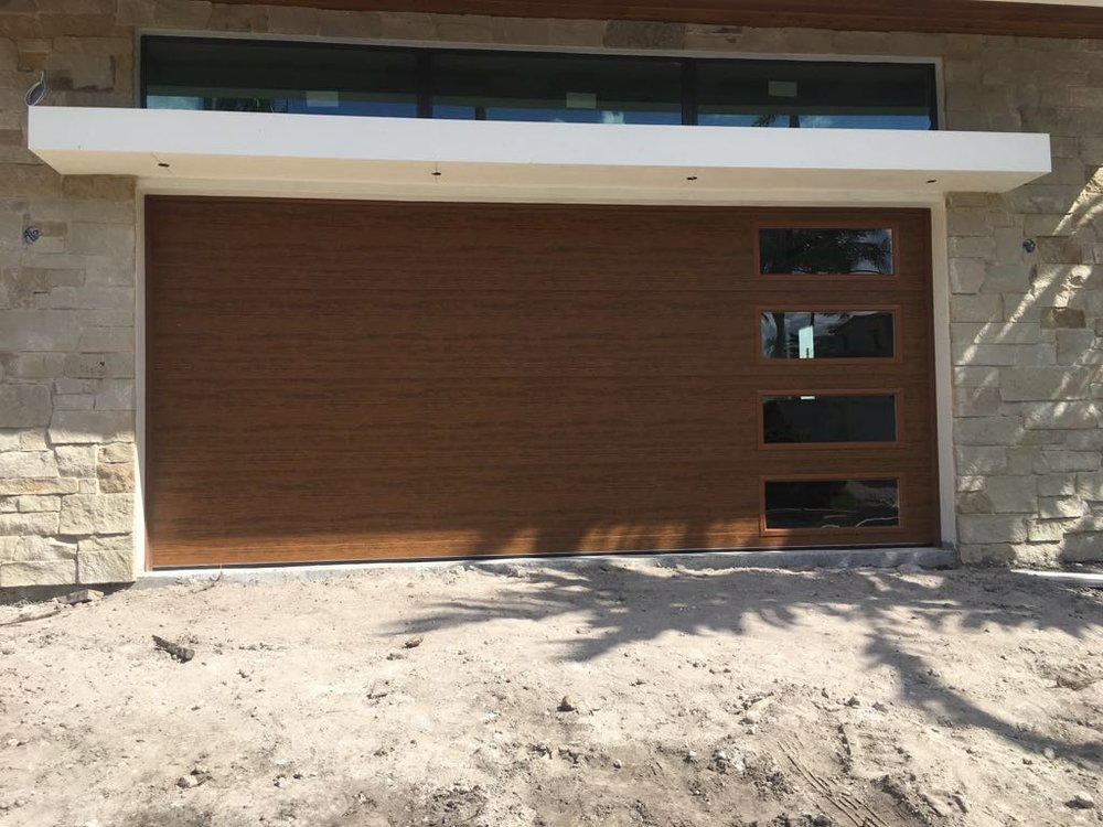 Clopay medium finish modern steel collection with long for Clopay steel garage doors