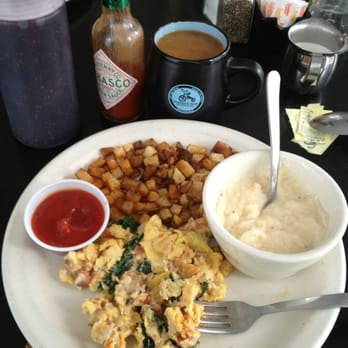 ... chicken, spinach, onions, cheese... Plus cheesy grits and potato hash