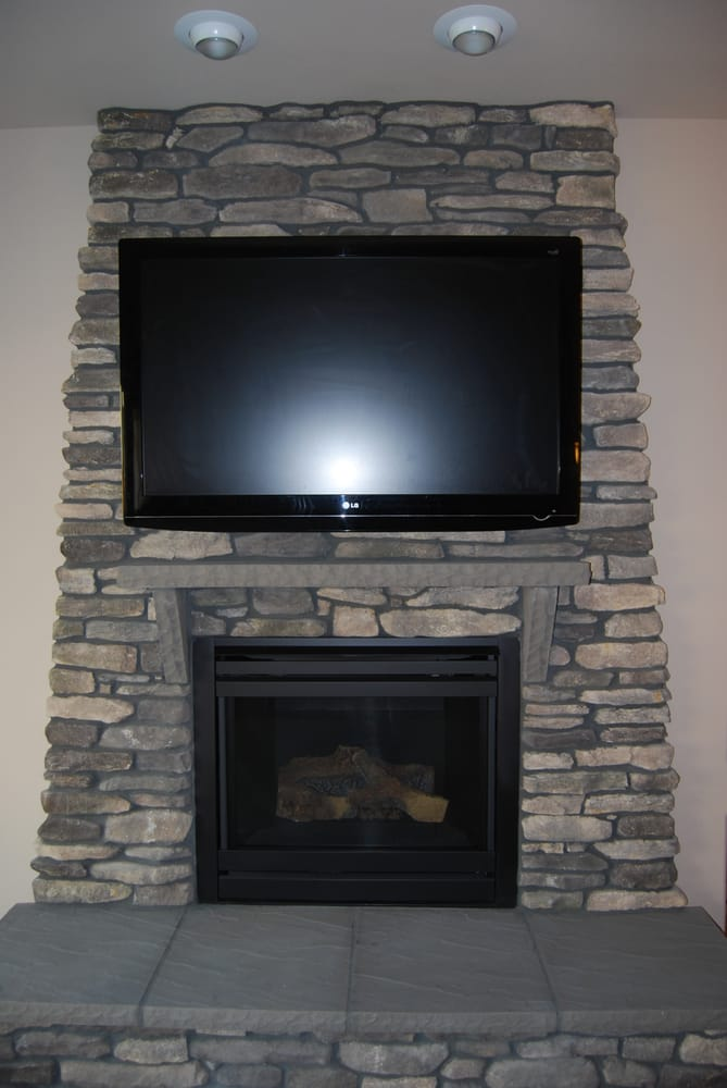 this tv was mounted on a stone surface above the fireplace yelp. Black Bedroom Furniture Sets. Home Design Ideas
