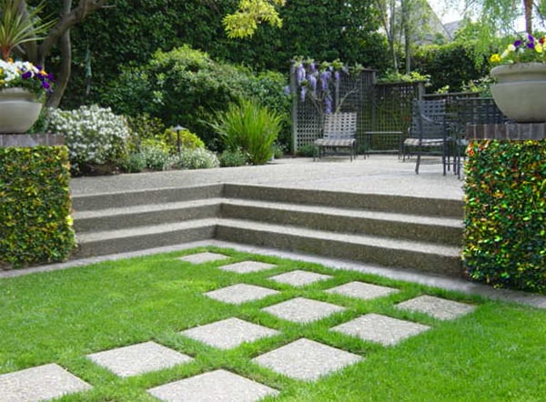Exposed aggregate concrete pavers traverse the lawn to ... on Backyard Ideas Concrete And Grass id=71703