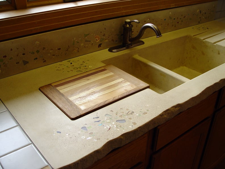 Sunshine yellow concrete counter with an integrated sink for Concrete kitchen countertops reviews