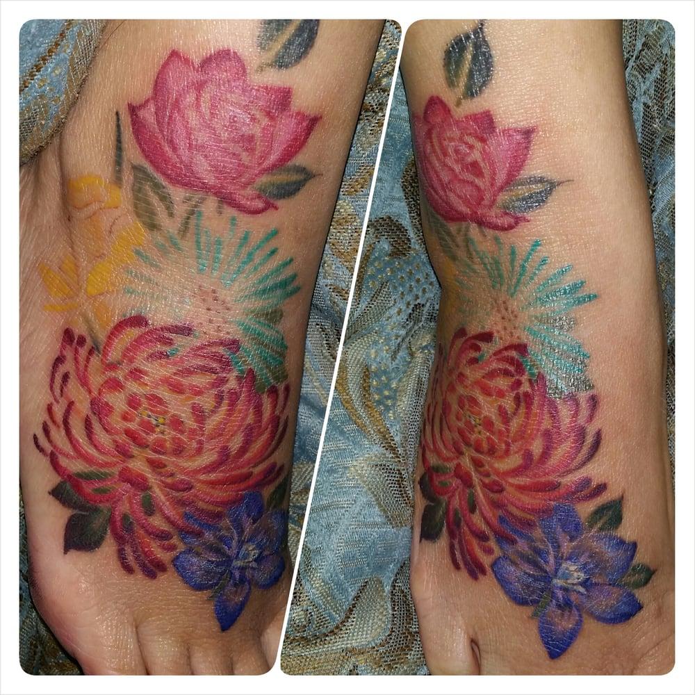 Watercolor foot tattoo in progress - Yelp