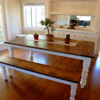 farmhouse dining table with oversized and distressed spun legs