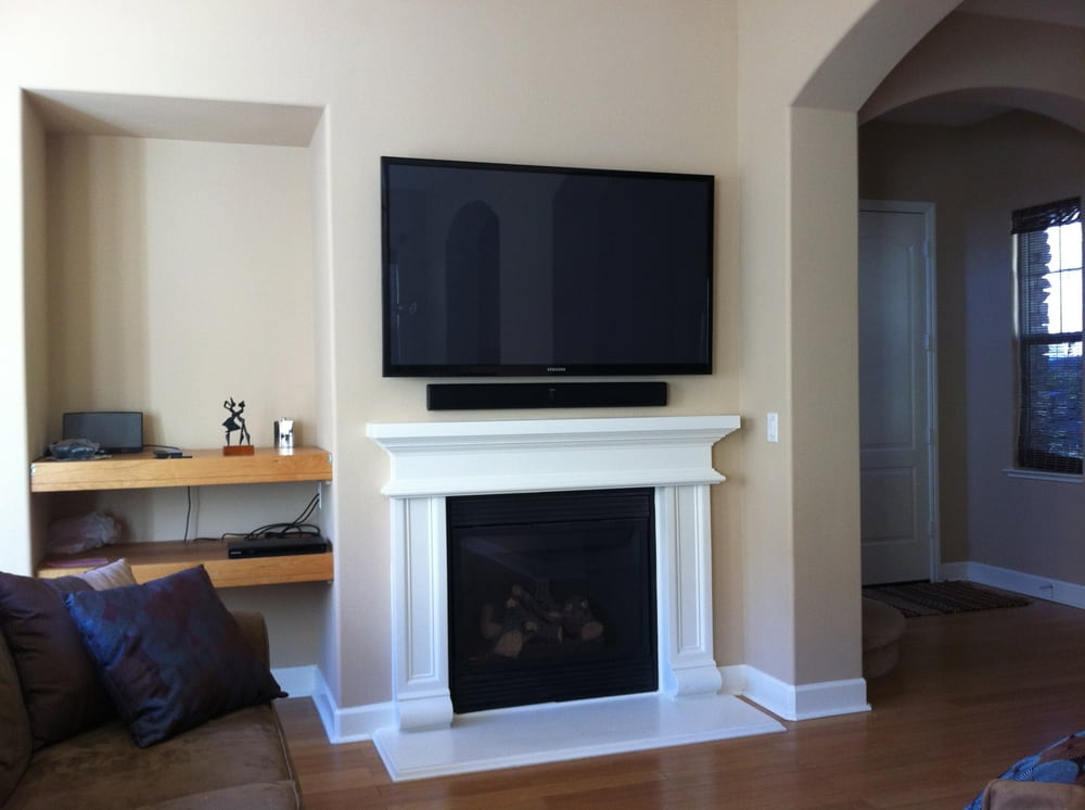Photo of Handy Green Home Solutions - Reno NV United States. 60 inch & 60 inch TV wall mounted with sound bar. Concealed wires for extra ...